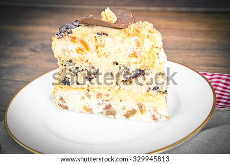 Delicious Honey Cake Decorated with Chocolate. Studio Photo
