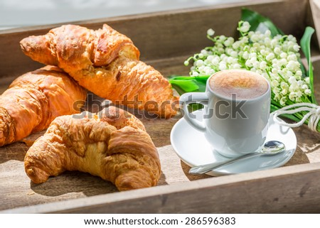 Delicious hot coffee and fresh croissant