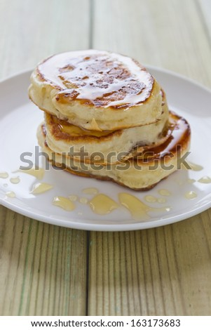delicious pancakes with honey in a plate on the table