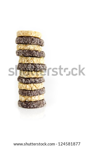 Delicious pile of petit four isolated on white background