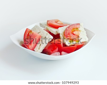 delicious salad with tomatoes, cheese and olive oil