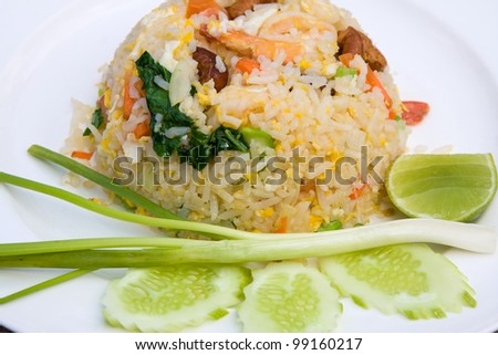 delicious seafood fried rice with shrimp, crab eggs and a light garnishing of spring onions. served with traditional sauces.