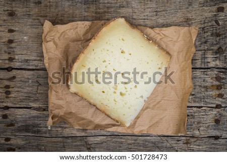 Delicious slice of fresh pecorino cheese from Italy