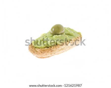 delicious starter of a bread toast with olive against a white background
