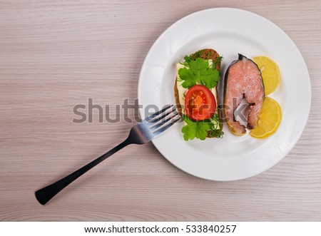 Delicious steak fillet red salmon fish on a plate.