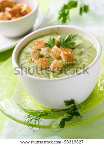 Delicious vegetable soup with potato, broccoli, green beans and parsley