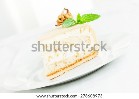 Delicious walnut cream cake with mint leaf