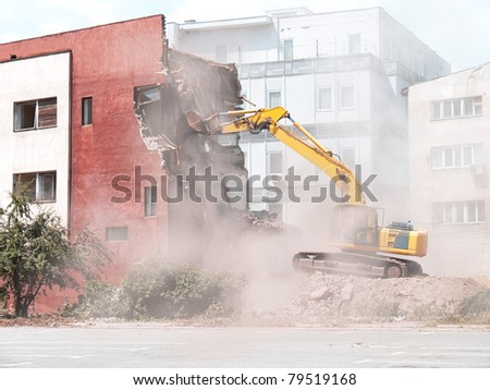 demolition of old building with bulldozer