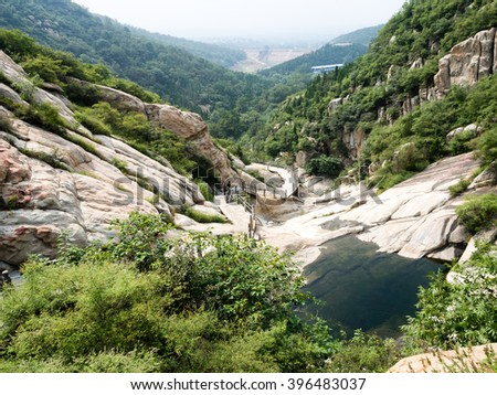 Dengfeng, China - July 28, 2013: Water streaming in sacred Songshan mountains
