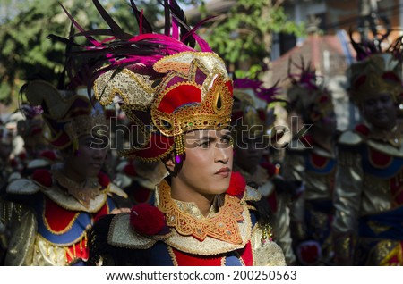 DENPASAR, BALI, INDONESIA - JUNE 18: Balinese dressed in a colorful variety in the parade in Bali Art Festival on June 18, 2014 in Denpasar, Indonesia
