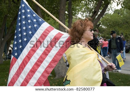 DENVER, COLORADO – APRIL 15: A women displays her U.S. flag at the Tea Party Patriots Rally in Downtown Denver, April 15, 2011