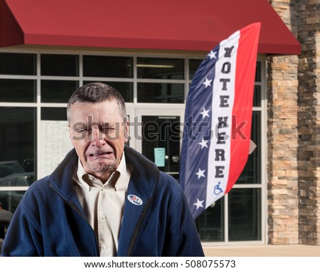 Depressed and weeping voter outside  an early voting ballot location for the 2016 USA Presidential election after making his choice