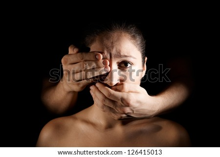 depressed woman being held silent by male hands