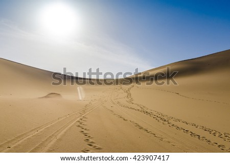 desert under blue sky with foot print