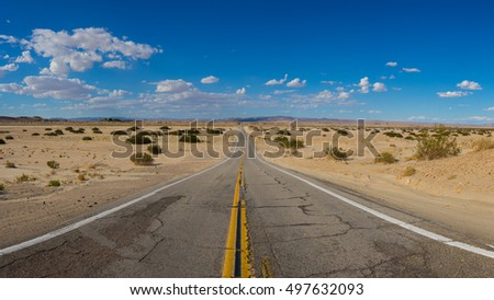 Deserted road leads into the wilderness of the southwestern desert.
