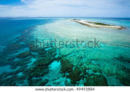 Deserted tropical island and coral reef from above, Okinawa, Japan