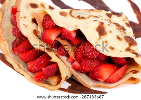 dessert: isolated pancakes with strawberry and chocolate