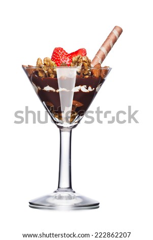 Dessert with nuts and chocolate decorated with strawberry. Sweet food. Parfait
