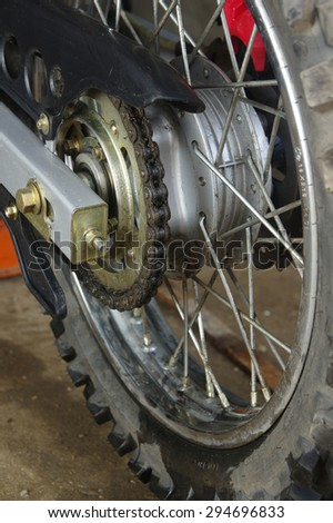 Detail of a motorcycle rear chain on wheel