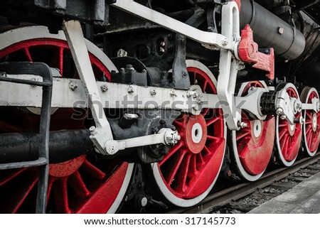 Detail of a steam locomotive. Wheel close-up