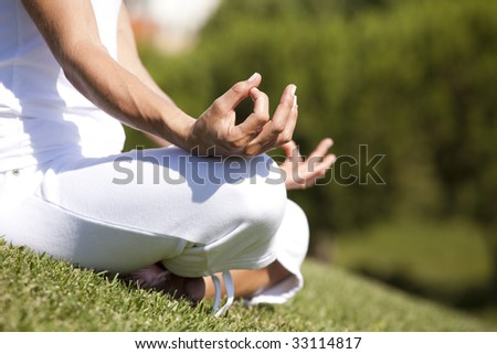 detail of a woman hands in yoga pose (selective focus)