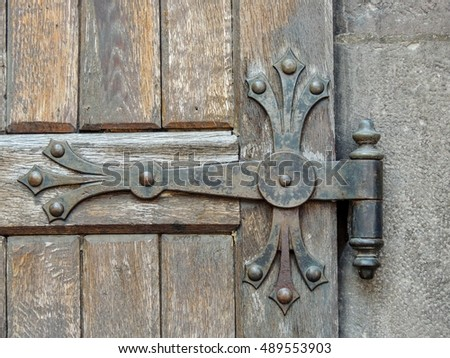 Detail of an old wooden door with medieval crafted iron hinge & Double Wooden Door Chained Closed Stock Photo 333425141 - Shutterstock pezcame.com