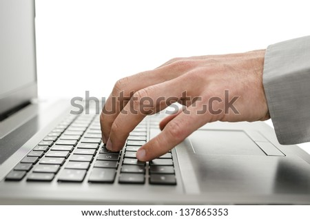 Detail of business man hand using laptop. Isolated over white background.