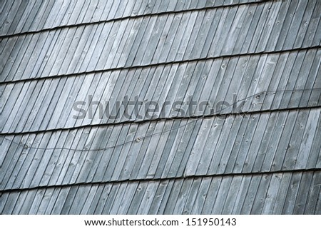 Detail of protective wooden shingle on the old roof as background