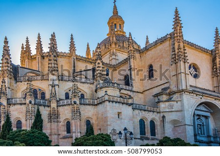 Detail of the Cathedral of Segovia, Spain, with the sun setting behind giving an ethereal glow.