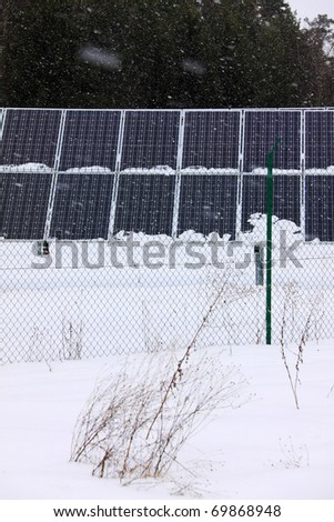 Detail of the Solar Power Station in the snowy Nature