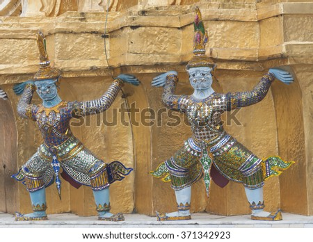 Detail of traditional mosaic tile Demon Guardian statue. Grand Palace, Bangkok. Thailand.(public temple)