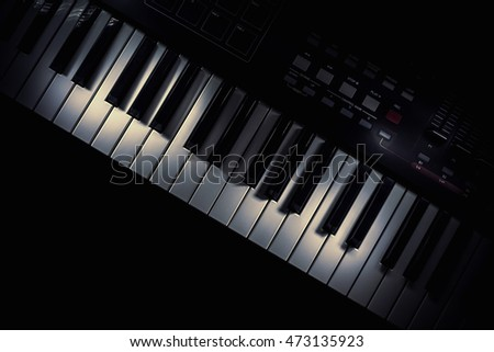 Details of a keyboard, accentuated keys with illumination.