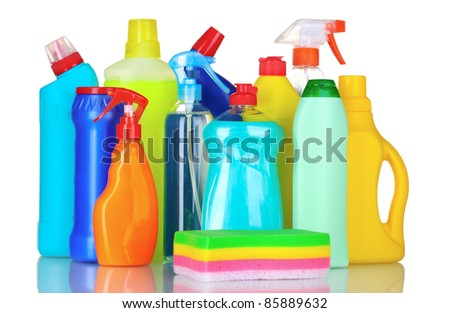 detergent bottles and sponge isolated on white