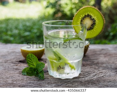 detox water cocktail on wooden table of  garden