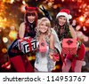 devil, angel and santa giving gifts - stock photo