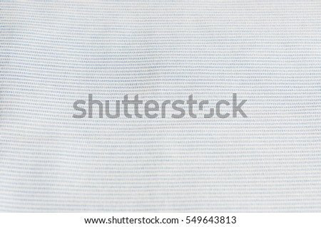 Diagonal lines pattern. Blue and white stripe texture background close up.