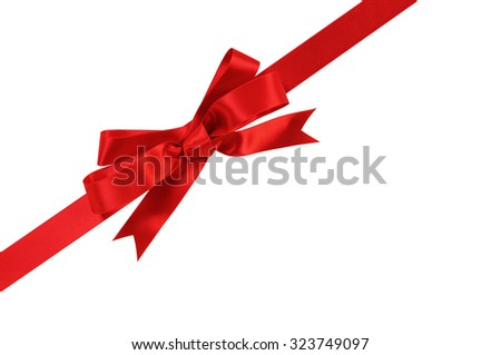 Diagonal red gift bow ribbon isolated on white background