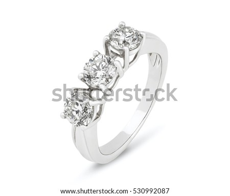 Diamond ring. Diamond ring isolated on white background. Ring with three diamonds. Golden wedding rings. White gold.