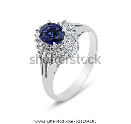 Diamond ring. Diamond ring with sapphire isolated on white background. Ring with diamonds and  large sapphire. Golden wedding rings.
