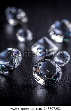 Diamonds on black background, close up