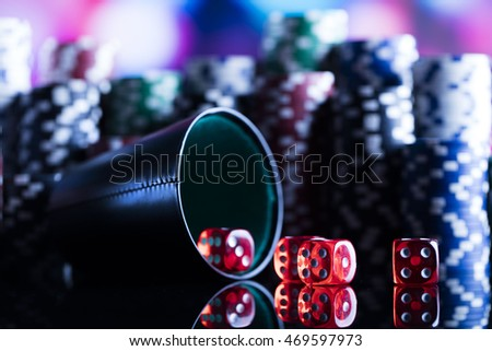Dice game, Poker Chips on a gaming with high contrast casino roulette, dramatic lighting, Blur background in casino and few colors, swallow depth of field on bokeh