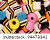 Different all sorts sweets in a pile with different shapes, sizes and colors - stock photo