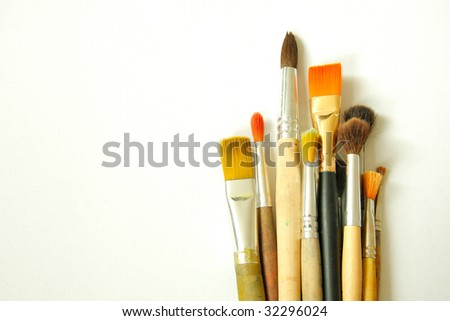 different art brushes isolated on white background
