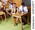 Different business people sitting in a caf�© - stock photo