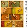 Different colored ground spices powders and solid with wooden spoons in a wooden box as a background - stock photo