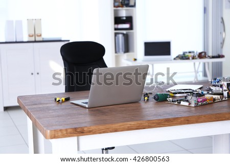 Different computer details on wooden table, indoors