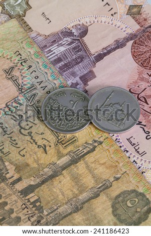 Different Egyptian coins and banknotes on the table