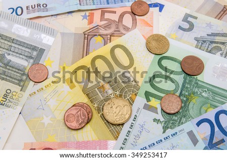 Different Euro banknotes with coins