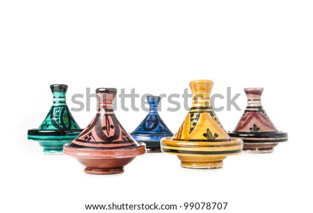 Different handmade ceramic Tajines isolated on a white background