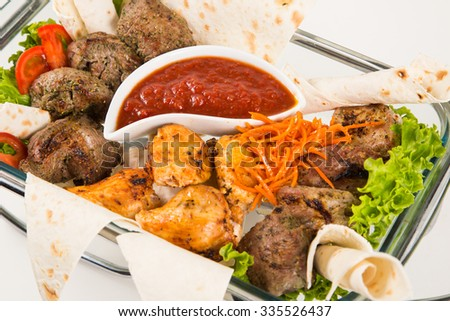 different meat with vegetable and armenian bread